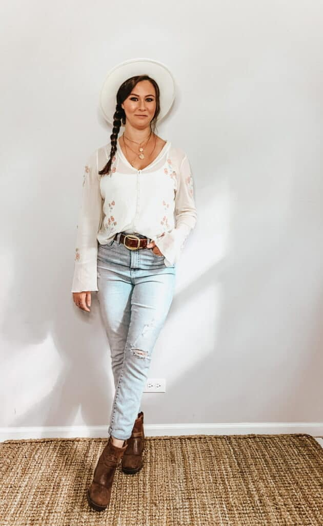 These thrifted fall basics are perfect for all your casual fall outfits. This cream sheer button down blouse with pink and green floral embroidery pairs perfectly with these high rise light wash jeans, a cream hat, a brown belt, and some brown ankle booties.