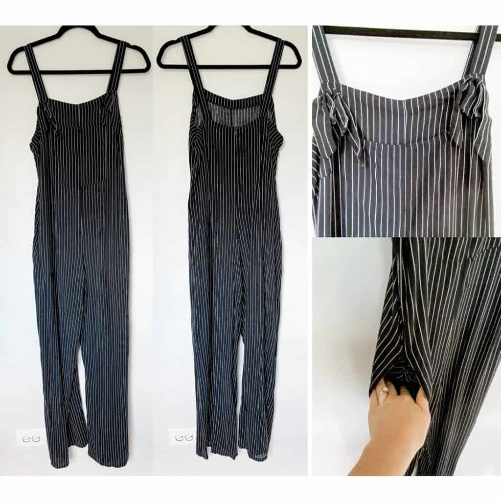 Overalls that are black with a thin white pin stripe, the straps loop through a hole in the front on either side and are tied in a knot to secure.