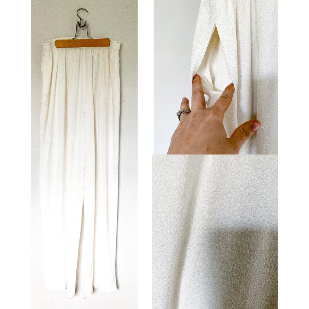 Cream high waisted trousers that have an elastic waistband and wide legs.