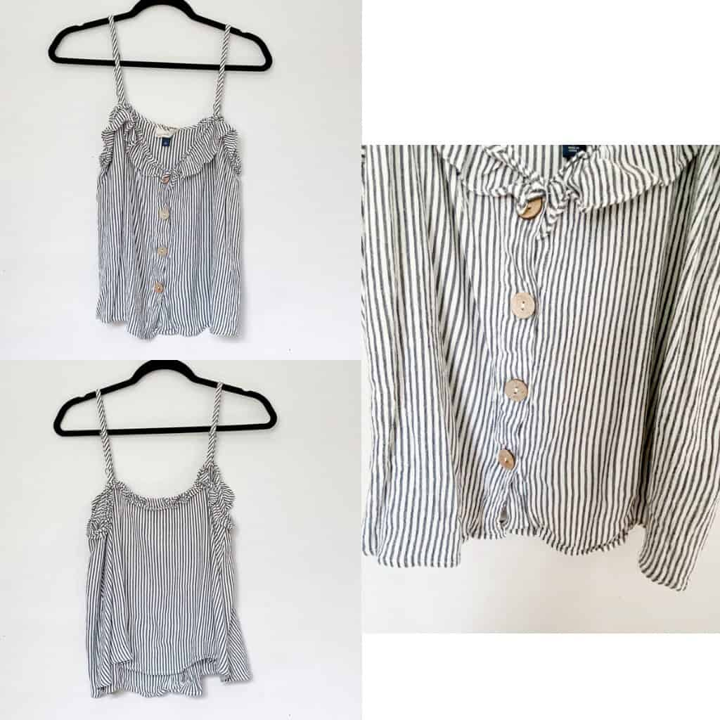 A light blue and white striped tank top with wood buttons down the front and a ruffled neckline.