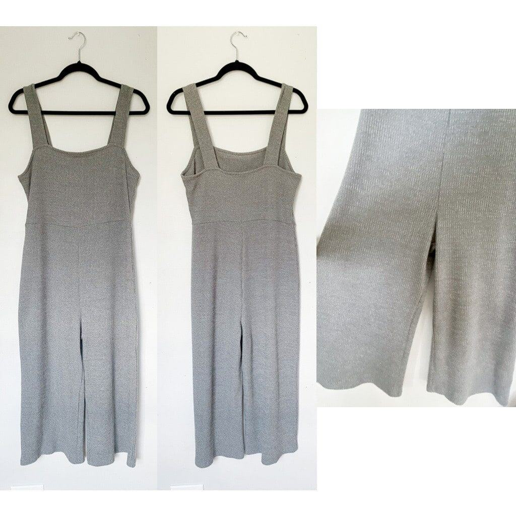 A gray ribbed jumpsuit that has cropped wide legs.