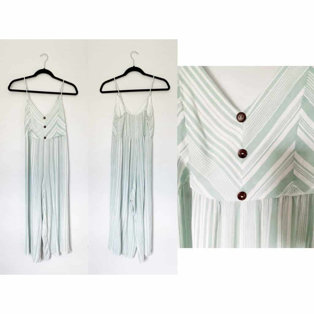 A white and light green striped jumpsuit with brown faux wood buttons.