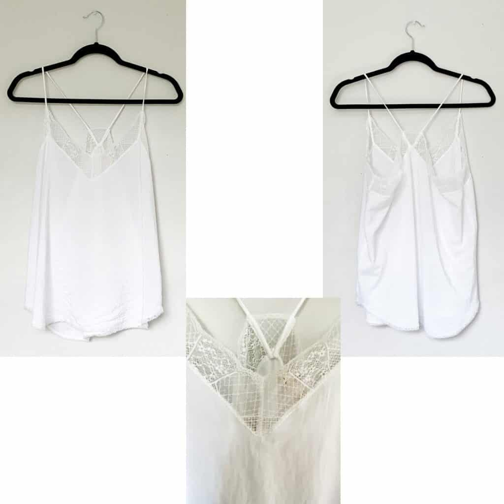 A white camisole with lace trim along the neckline.