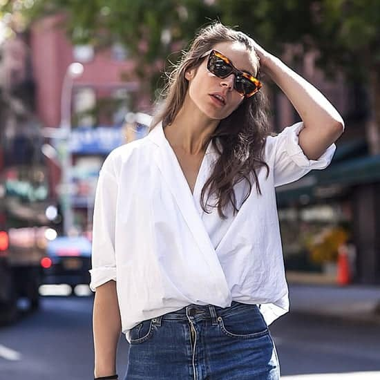 How to style a button down shirt. Wear it unbuttoned and crisscrossed then tuck it in for a trendy look.