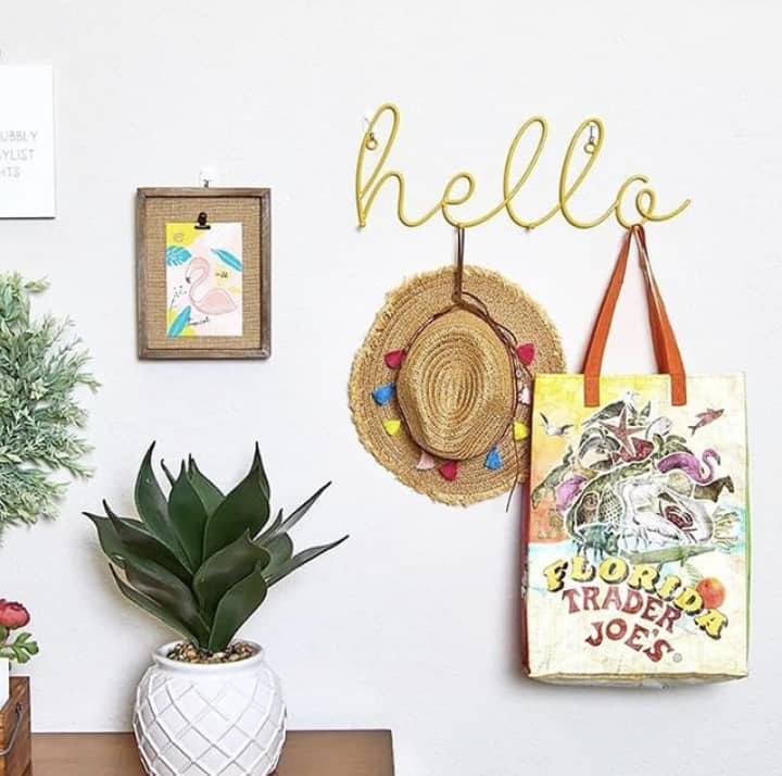 This yellow hello wall hook sign which is one of the items you will receive in your summer subscription box.