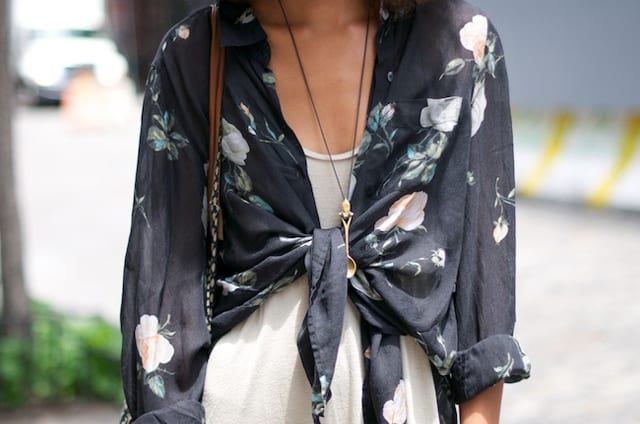 How to style a button down shirt. Wear it over a dress, unbuttoned and tie up the bottom of the shirt.