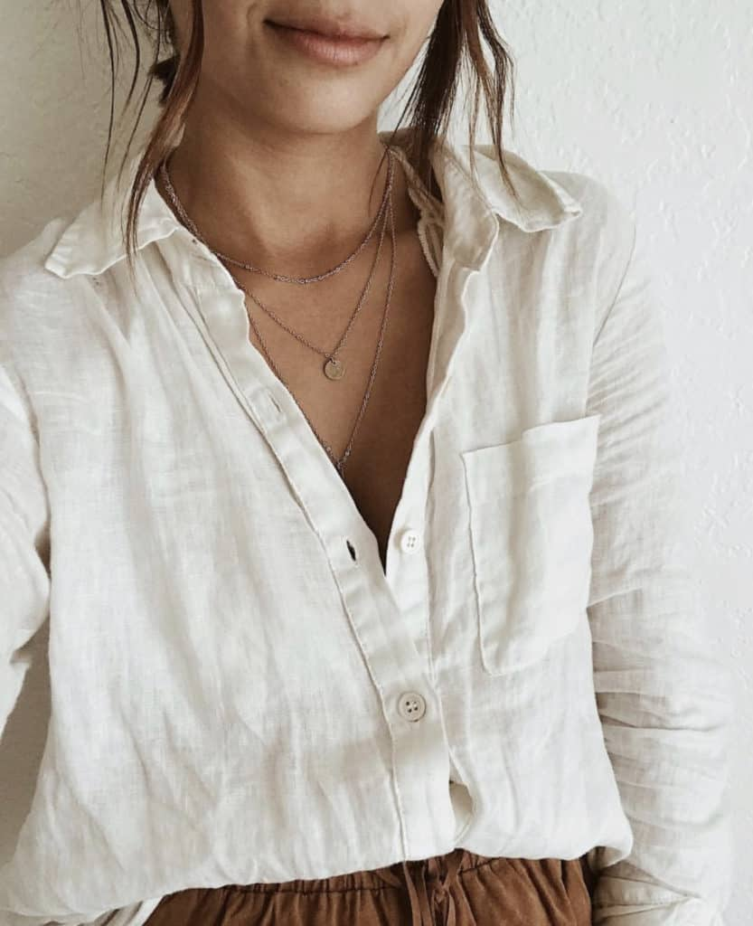 Wear a linen shirt loosely tucked in front with some linen pants in another color.
