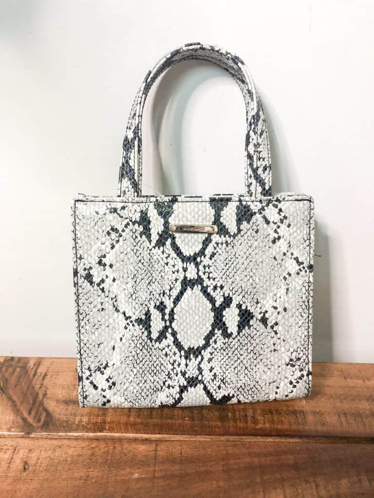 Fall Thrift Haul | This mini snakeskin handbag is very trendy for fall. It is the perfect little bag for a night out.
