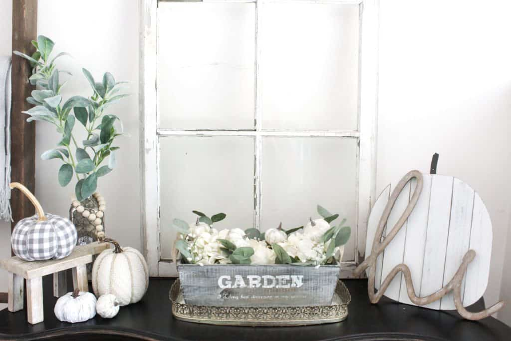 A great entryway table full of neutral fall decor.