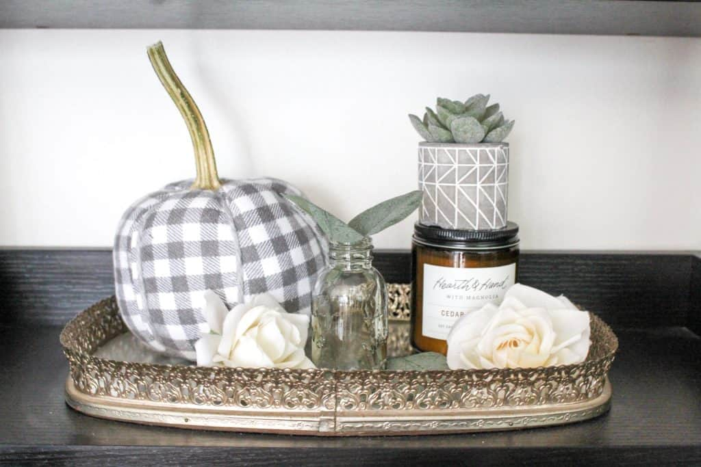 Neutral fall decor | A collection of fall items on a mirrored tray.