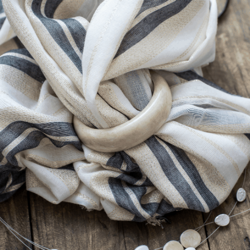 Switch to a lightweight scarf when transitioning your winter wardrobe to spring.
