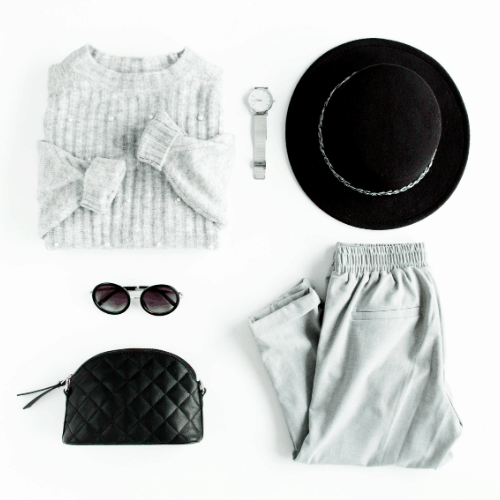 Get your closet ready to go from winter to spring by pairing a winter sweater with some light weight trousers.