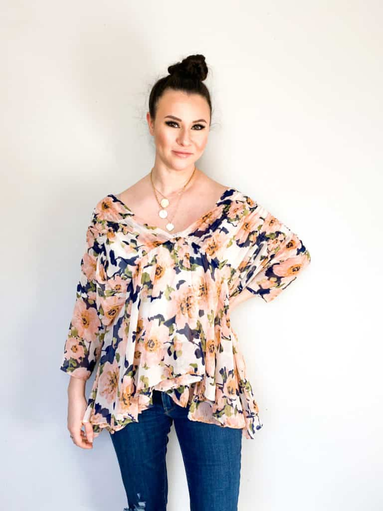 It's easy to find great layering pieces at the thrift store. I found so many great spring pieces that will work perfectly like this really pretty J.O.A. floral top. Check out the rest of my winter to spring thrift haul!