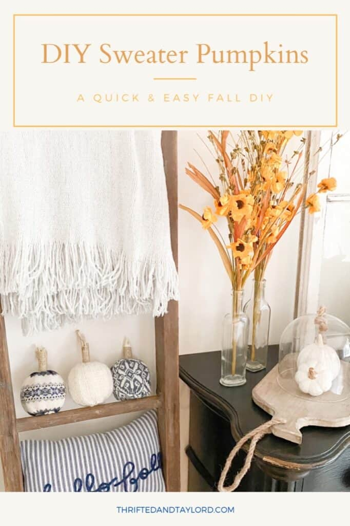 """Photo shows the 3 completed DIY sweater pumpkins sitting on an antique ladder underneath a grey throw blanket and above a blue and white striped pillow that says """"hello fall"""" It also shows a black antique looking dresser with some yellow paper flowers in some clear bottle vases, a wood tray with 2 ceramic white pumpkins underneath a glass cloche."""