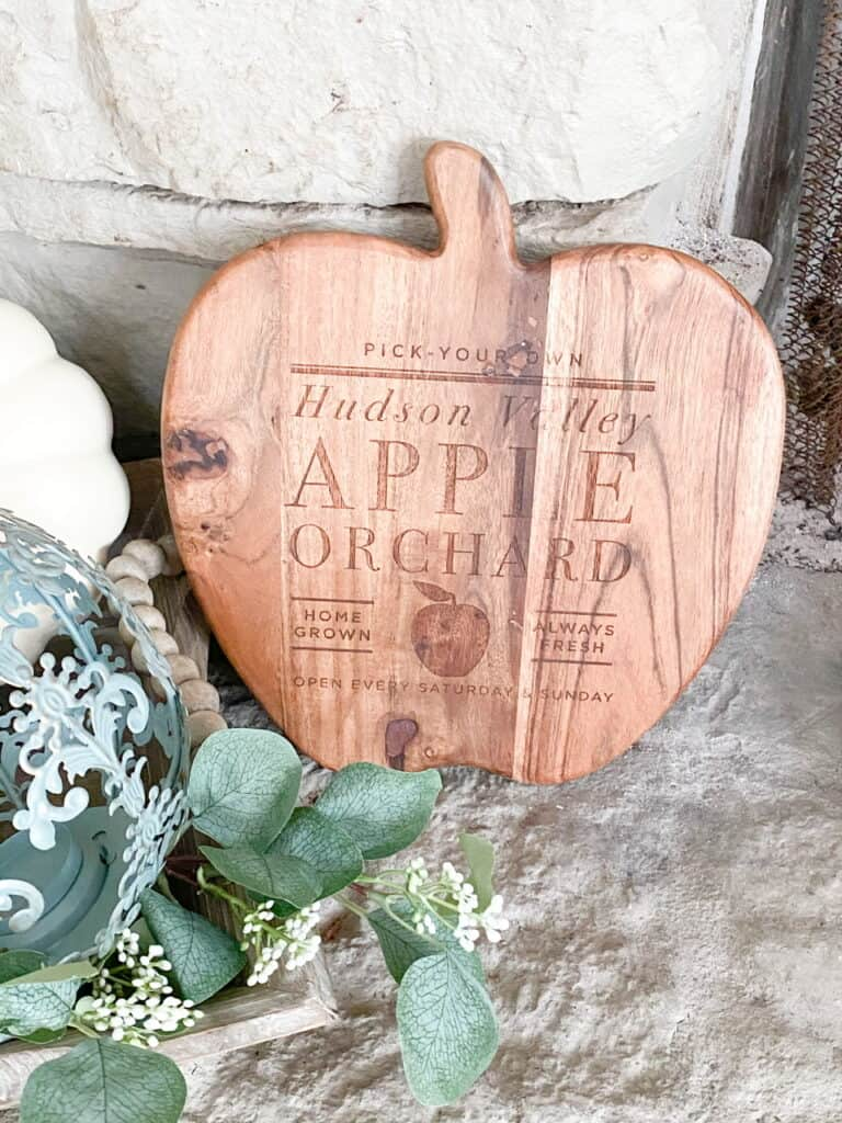 Neutral fall decor, a wooden apple orchard sign in the shape of an apple.