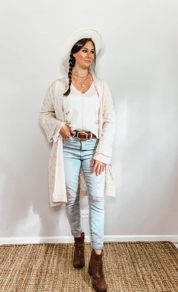 These thrifted fall basics are perfect for all your casual fall outfits. This cream sheer button down blouse with pink and green floral embroidery pairs perfectly with these high rise light wash jeans, a cream hat, a brown belt, and some brown ankle booties. Toss a cardigan over top for that cooler fall weather.