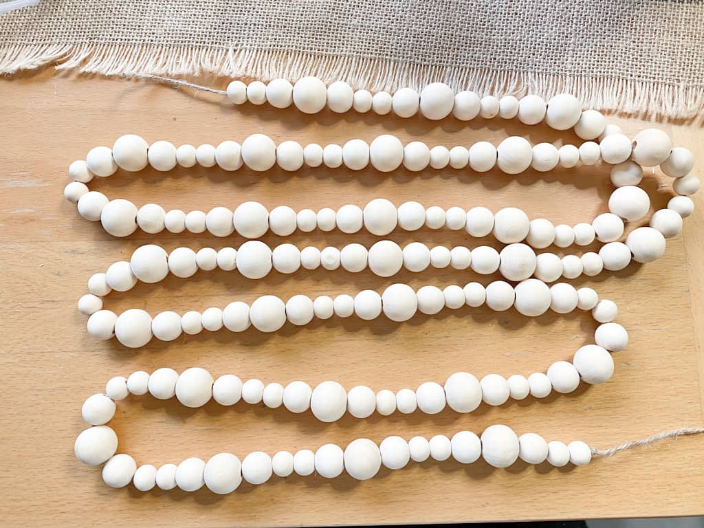 A wood bead garland made out of 3 different sized beads.
