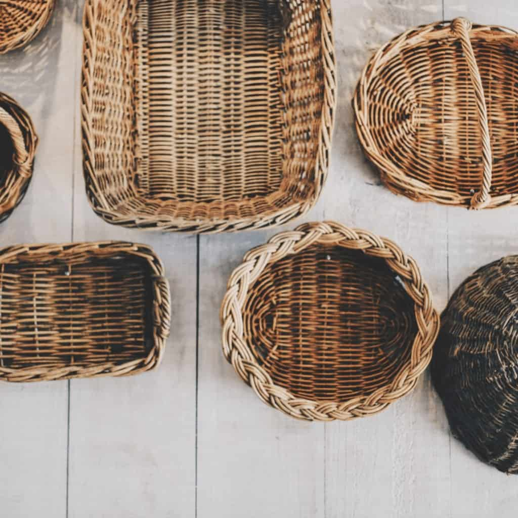 Image shows several different sizes and shapes of wicker baskets.