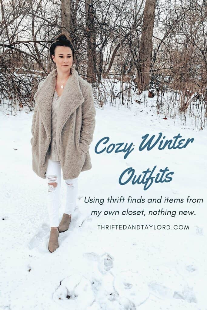 Photo shows a woman dressed in a gray teddy style jacket, a gray open knit sweater, some white distressed skinny jeans, a gold medallion necklace, and some taupe booties outside in the snow.