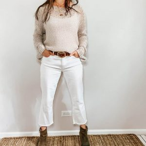 These thrifted fall basics are perfect for all your casual fall outfits. These white straight leg jeans with a cropped raw hem paired with this gray open knit sweater, brown belt, and brown booties are the perfect outfit for fall.
